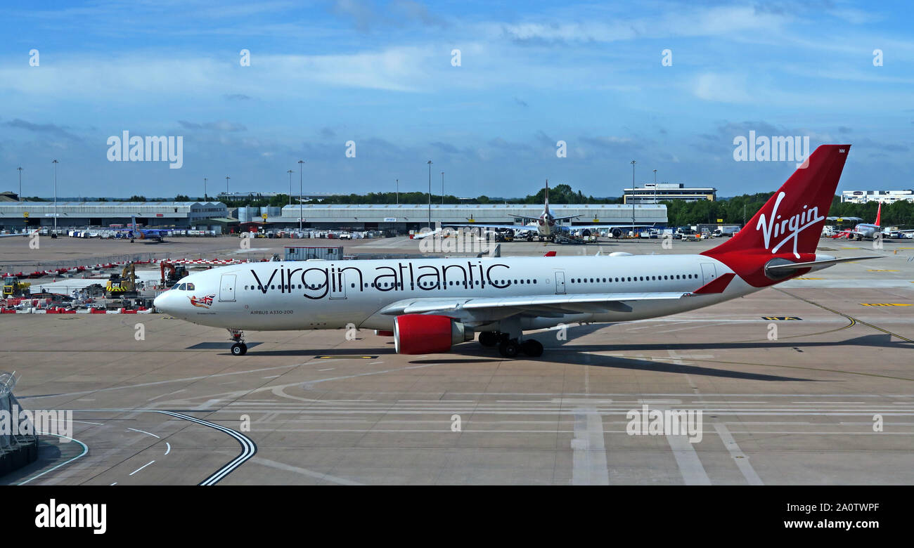 GoTonySmith,HotpixUK,@HotpixUK,MAN,MAG,apron,planes,jet,Boeing,Airbus,taxi,taxing,Ringway,UK,England,North West,A330-200,taxi-ing,Virgin Atlantic Airways,Limited,Virgin Holidays,Delta Air Lines,CAA,strike,fine,Richard Branson,transport,quality,Virgin Atlantic jet,VHQ,Virgin Flybe,merger,network,Flybe Virgin Atlantic,Flying Club,Connect Airways consortium,Connect Airways