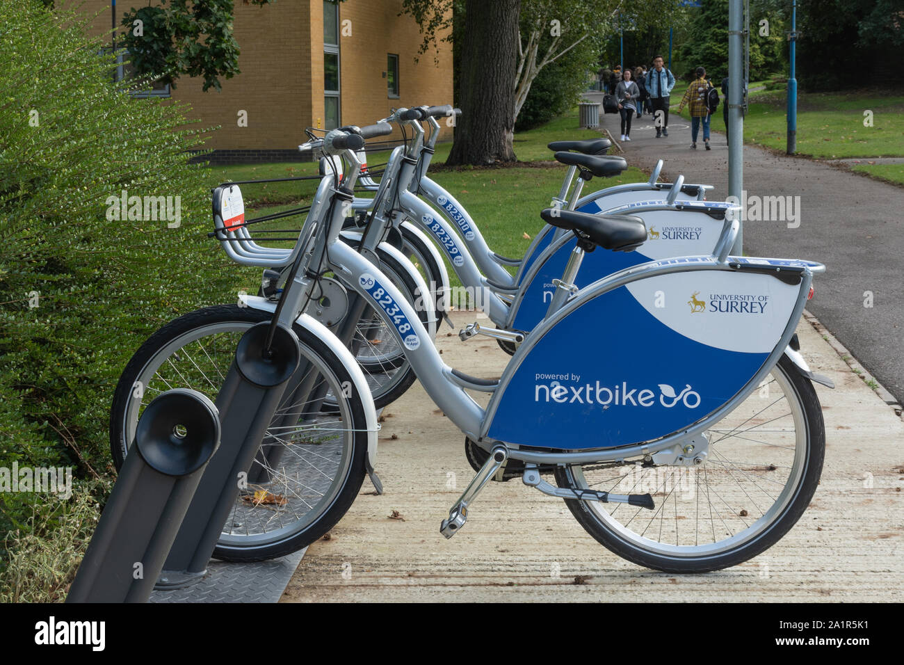 bike-share-scheme-bicycles-by-nextbike-on-the-university-of-surrey-campus-at-guildford-in-surrey-uk-2A1R5K1.jpg