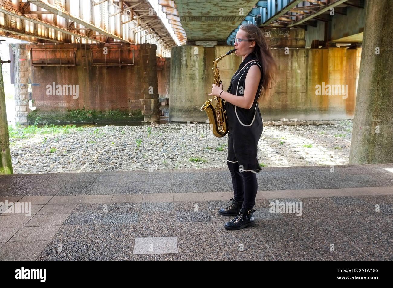 caucasian-teenage-girl-playing-saxophone