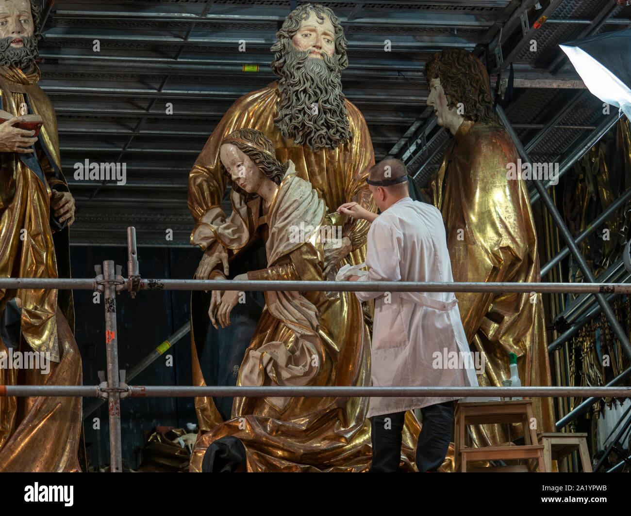 Krakow, Poland - 23rd Sep 2019: A man working on the renovation of the Altar of Veit Stoss in St. Mary's Basilica in Krakow, Poland. Stock Photo