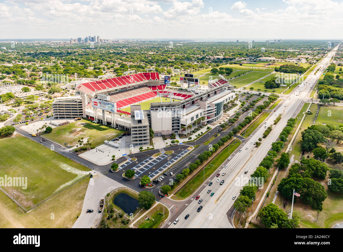 Raymond James Stadium football field and the Tampa or Tampa Bay skyline in an aerial view, Tampa Florida, USA. Stock Photo