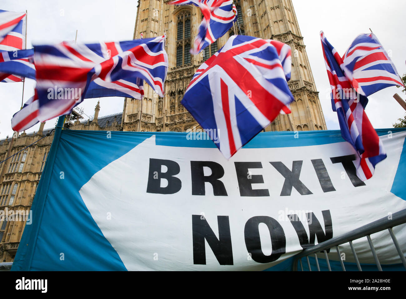 London, UK. 01st Oct, 2019. A banner saying, Brexit Now with Union Jack flags fluttering outside Houses of Parliament in Westminster. The British Prime Minister Boris Johnson is poised to reveal his final Brexit plan to EU leaders with less than a month to go before UK leaves the EU. Credit: SOPA Images Limited/Alamy Live News Stock Photo