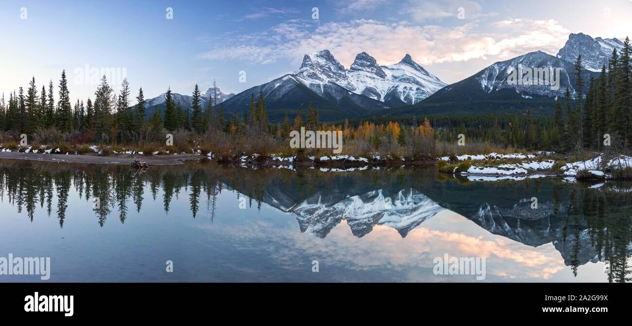 three-sisters-snowy-mountain-peaks-refle