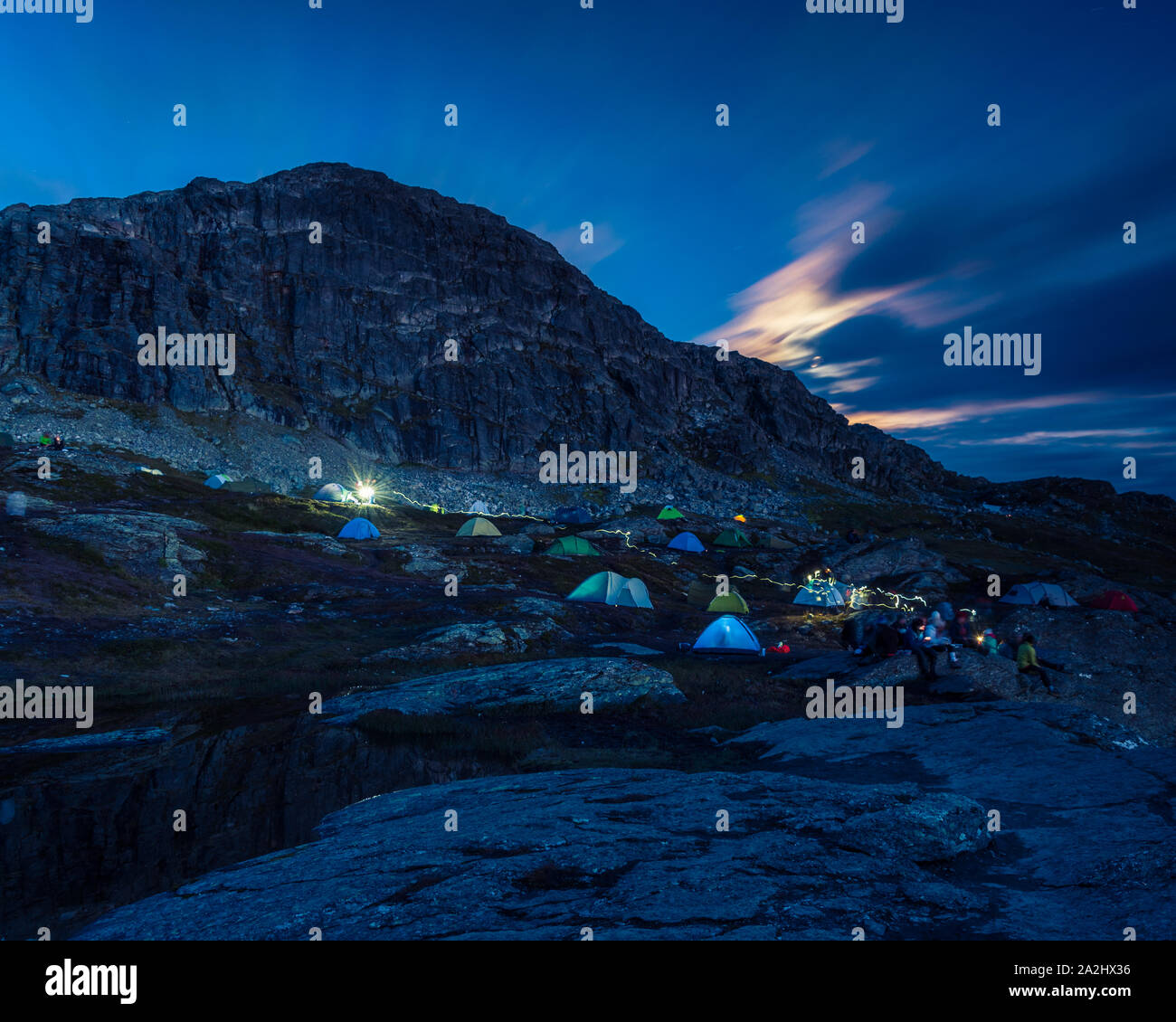 0209-17-trolltunga-norway-tourists-have-put-up-tents-to-spend-the-night-close-to-the-cliff-of-trolltunga-2A2HX36.jpg
