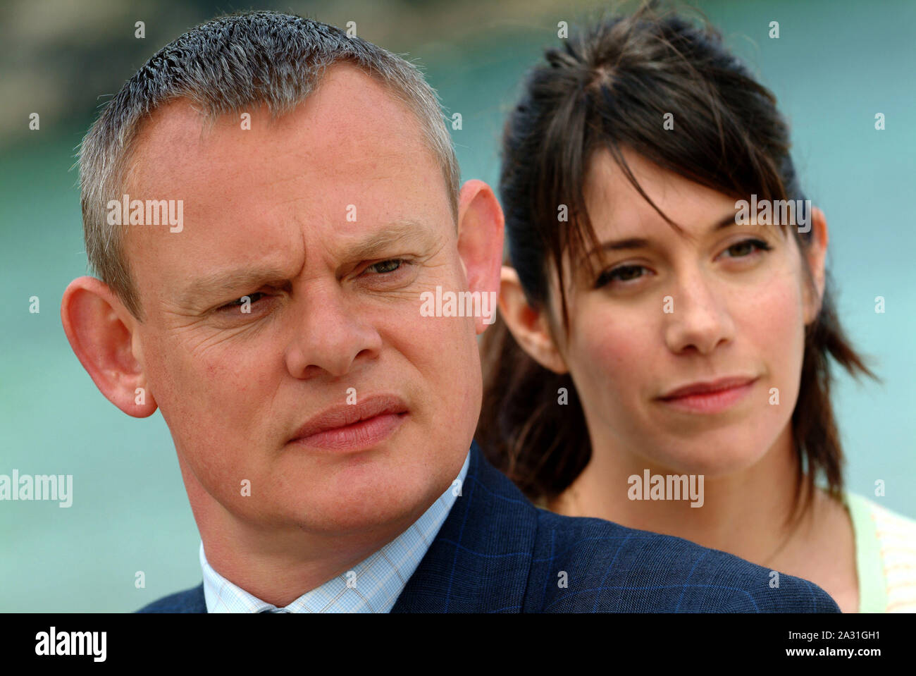 Doc Martin tv series,filmed in Port Isaac,Cornwall,UK,starring Martin Clunes & Caroline Catz,produced by Clunes wife Philippa Braithwaite(striped top) Stock Photo