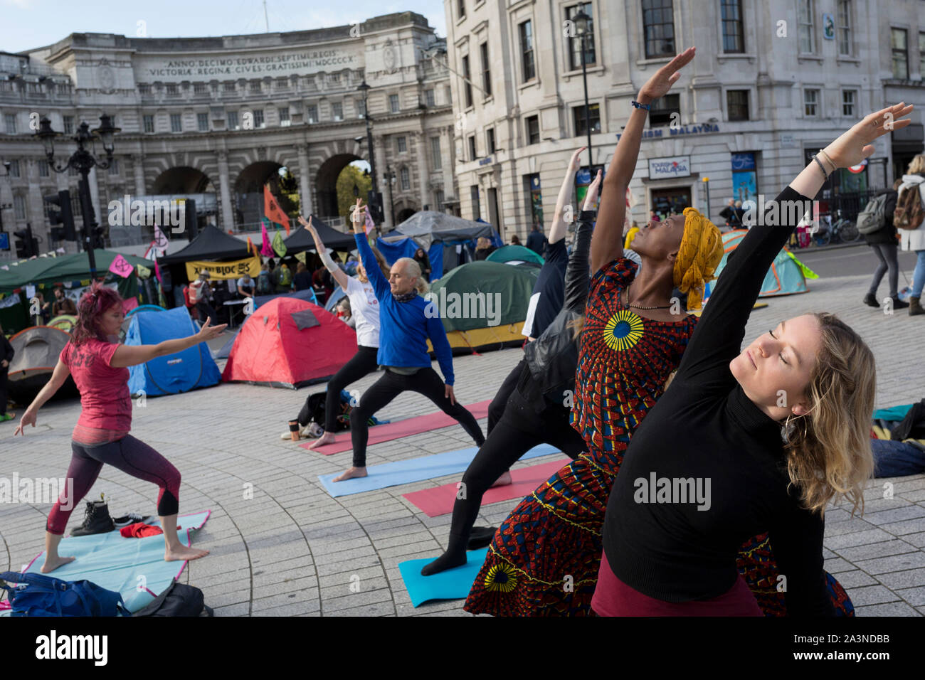 environmental-activists-practice-yoga-wh