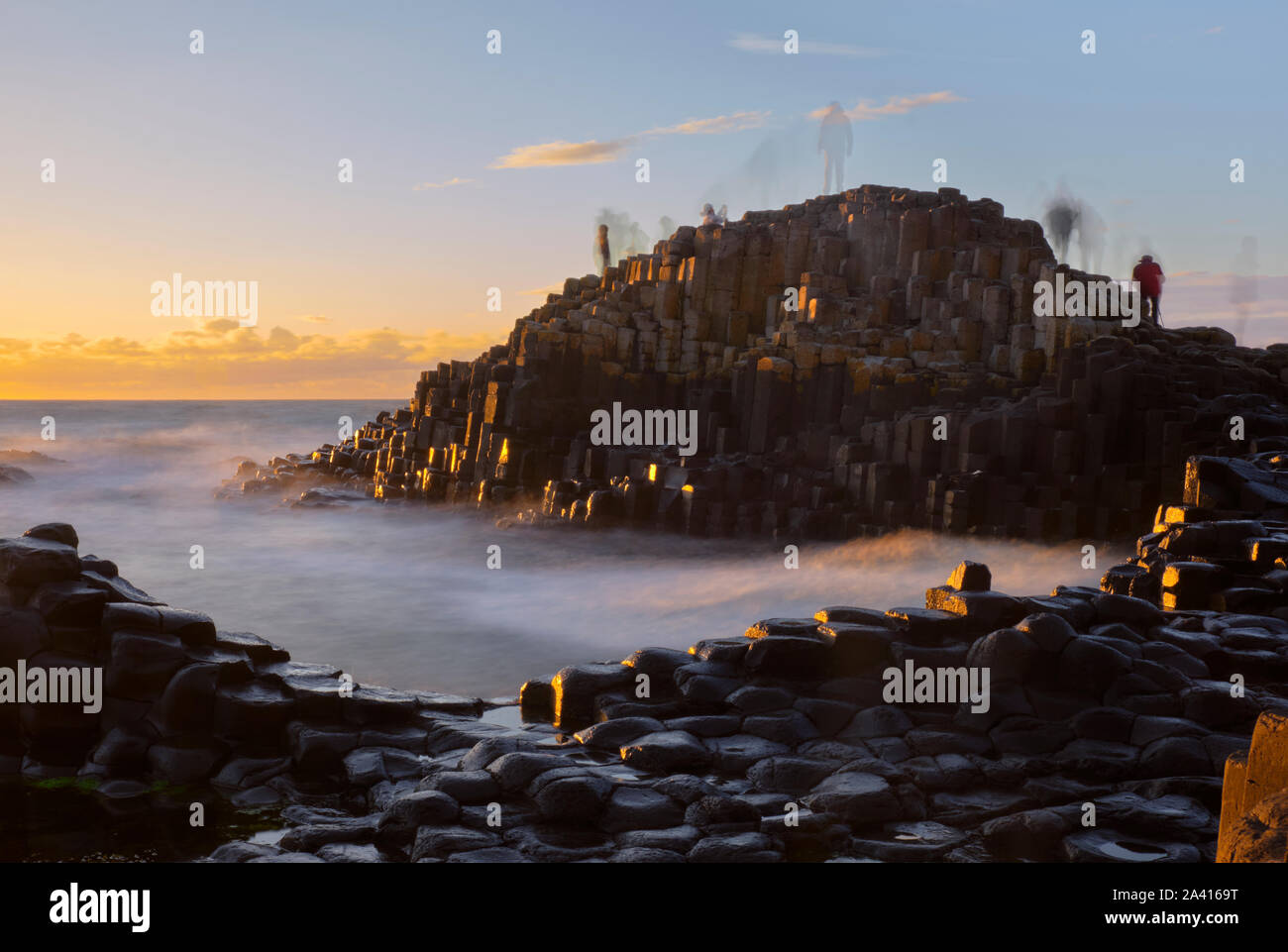 long-exposure-sunset-at-giant-causeway-with-shadows-of-moving-people-standing-on-rocks-creating-a-ghost-effect-2A4169T.jpg