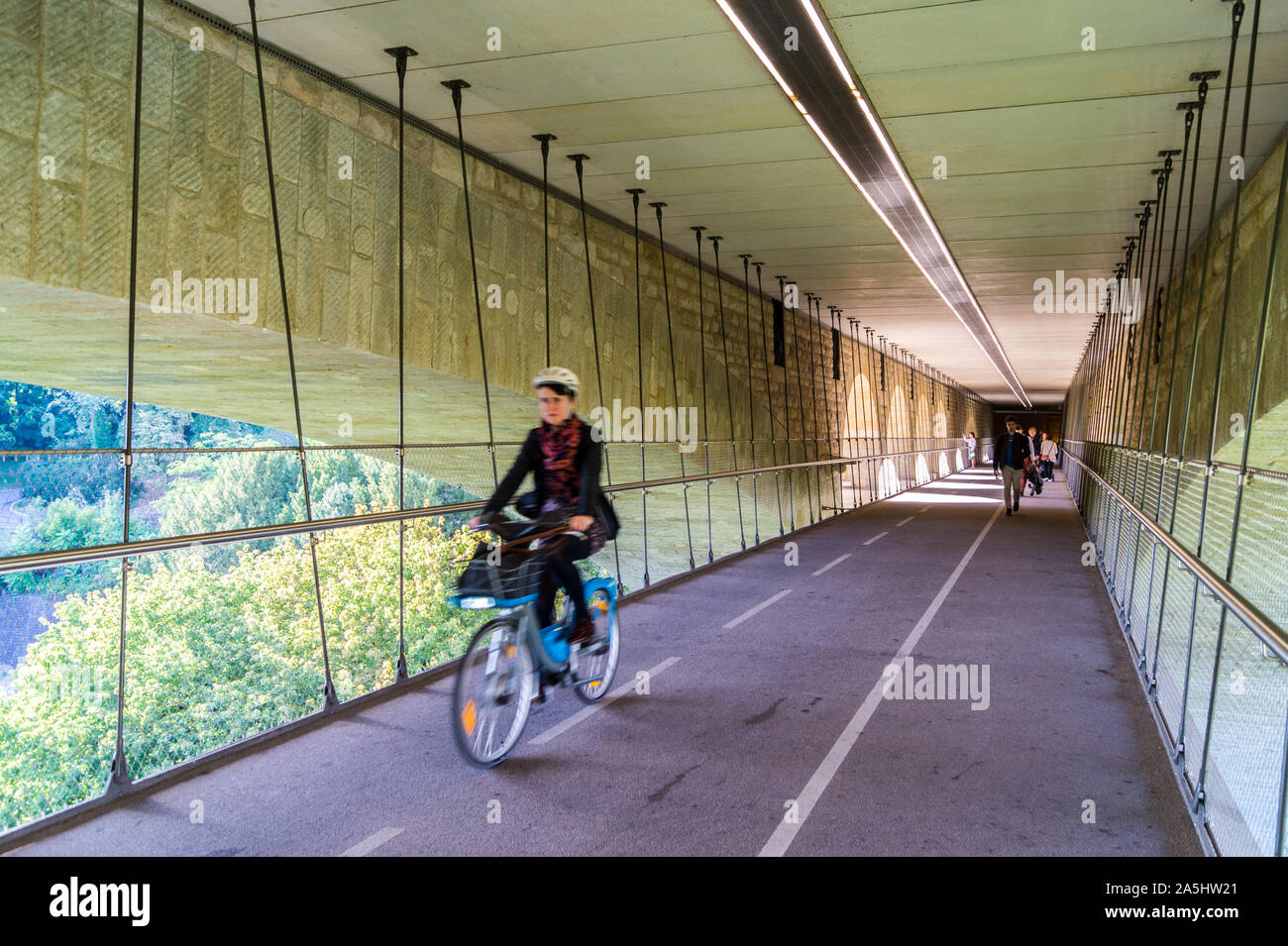 a-female-cyclist-on-the-cycle-path-suspended-under-pont-adolphe-adolphe-bridge-luxembourg-city-grand-duchy-of-luxembourg-2A5HW21.jpg