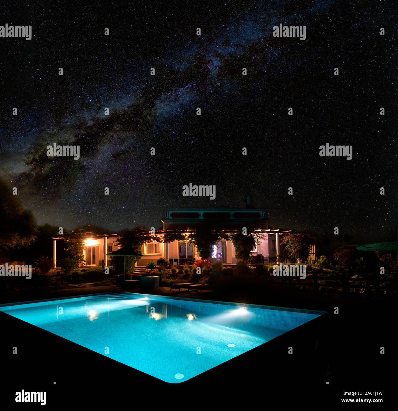 the-milky-way-above-an-illuminated-villa