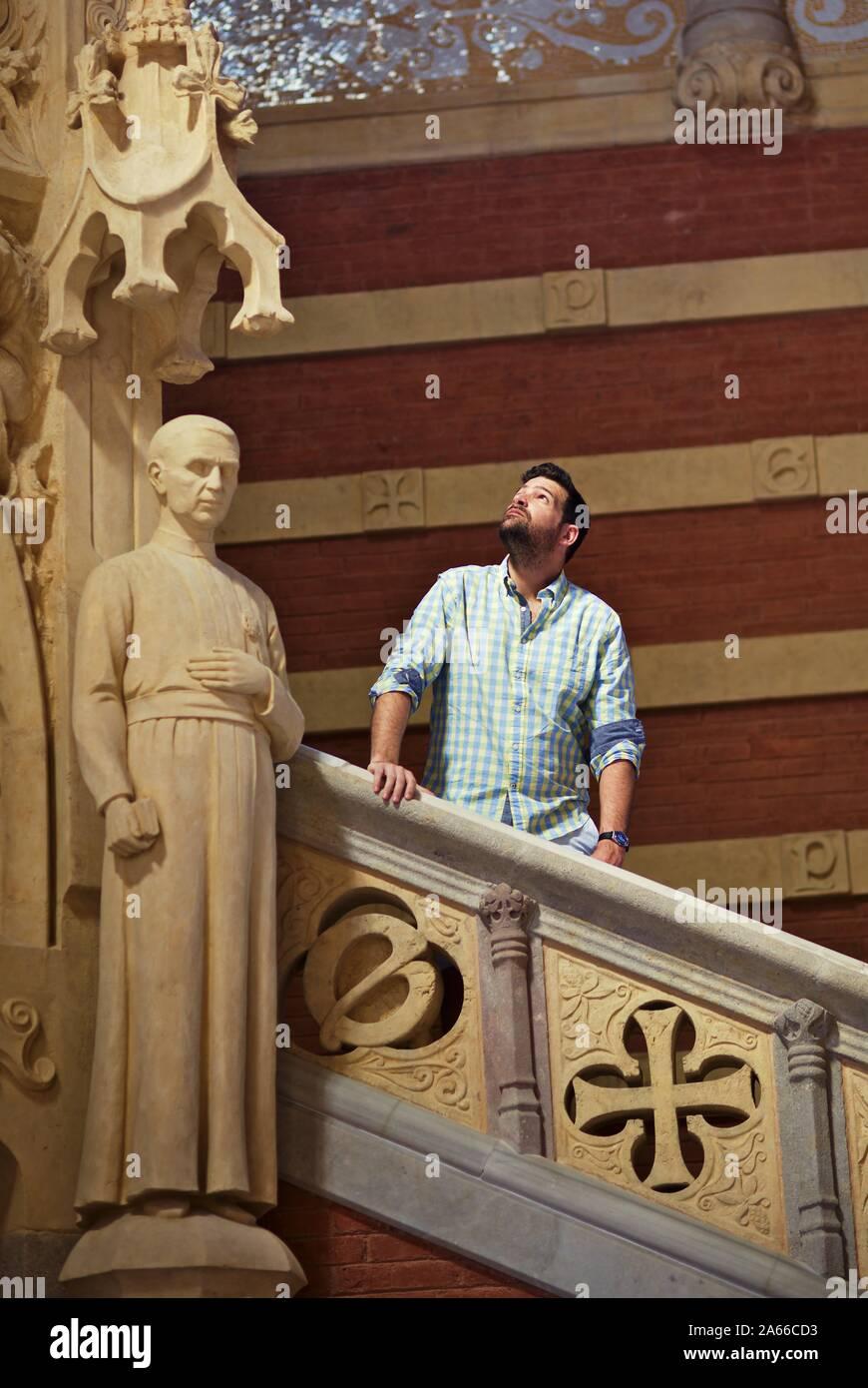 man-posing-on-stairs-inside-recinte-modernista-de-sant-pau-barcelona-2A66CD3.jpg