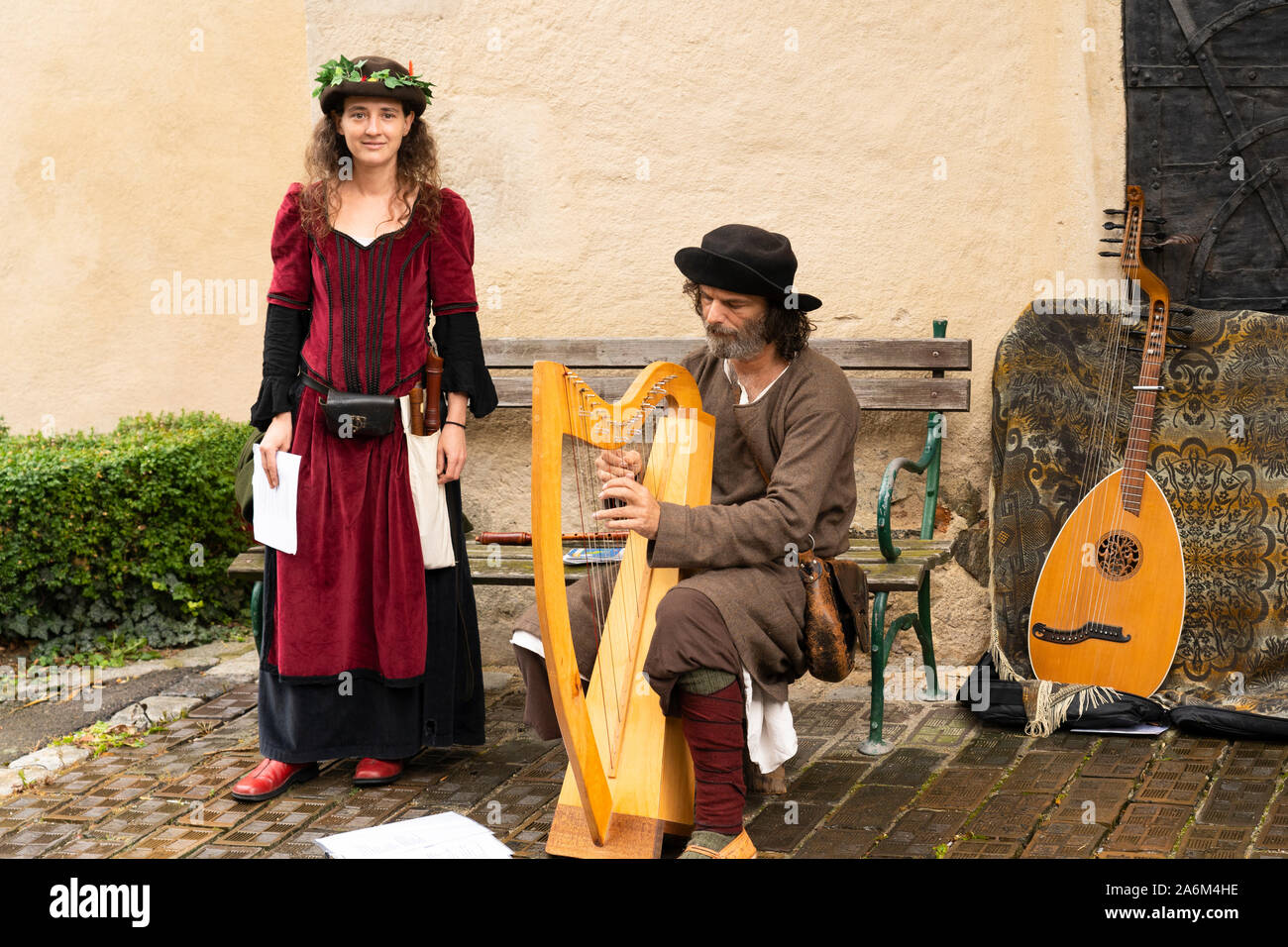 a-man-and-woman-in-medieval-clothes-play