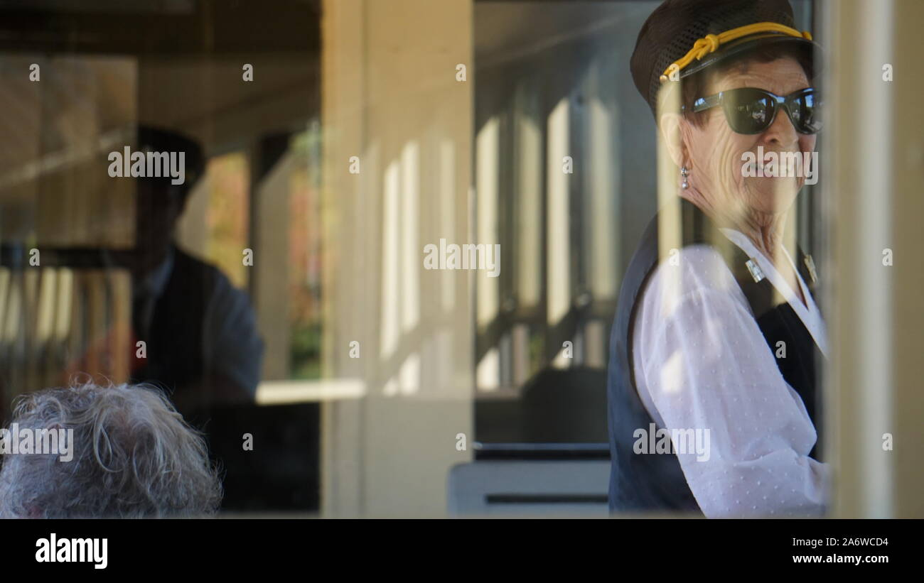 Train conductor taking tickets on a historic Sierra Railway steam engine train at Railtown 1897 State Historic Park in Jamestown, California, USA. Stock Photo