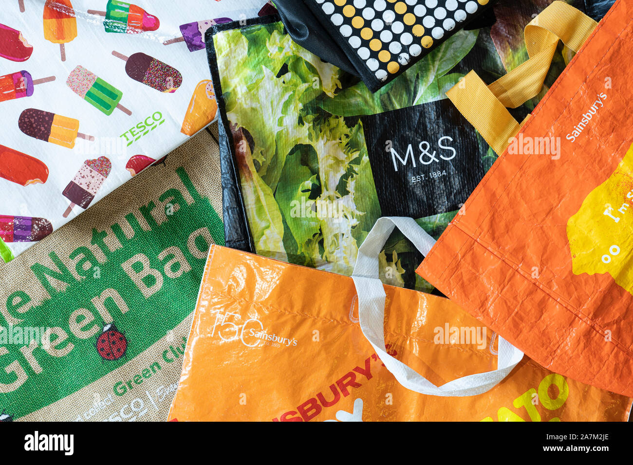 Bags for life from Tesco, Sainsbury, and Marks and Spencer. Concept - intention to reduce the use of single use plastic bags Stock Photo