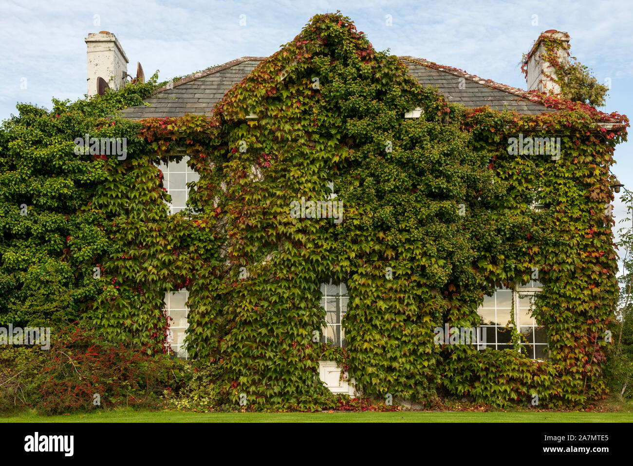 autumnal-scene-with-quirky-cottage-house