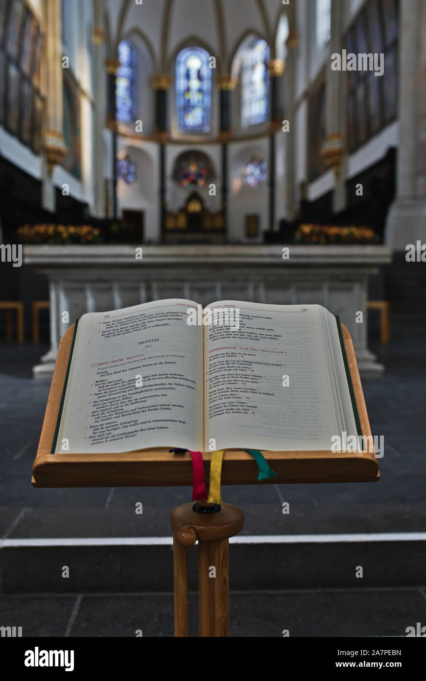 book-page-of-the-day-in-front-of-altar-in-church-2A7PEBN.jpg
