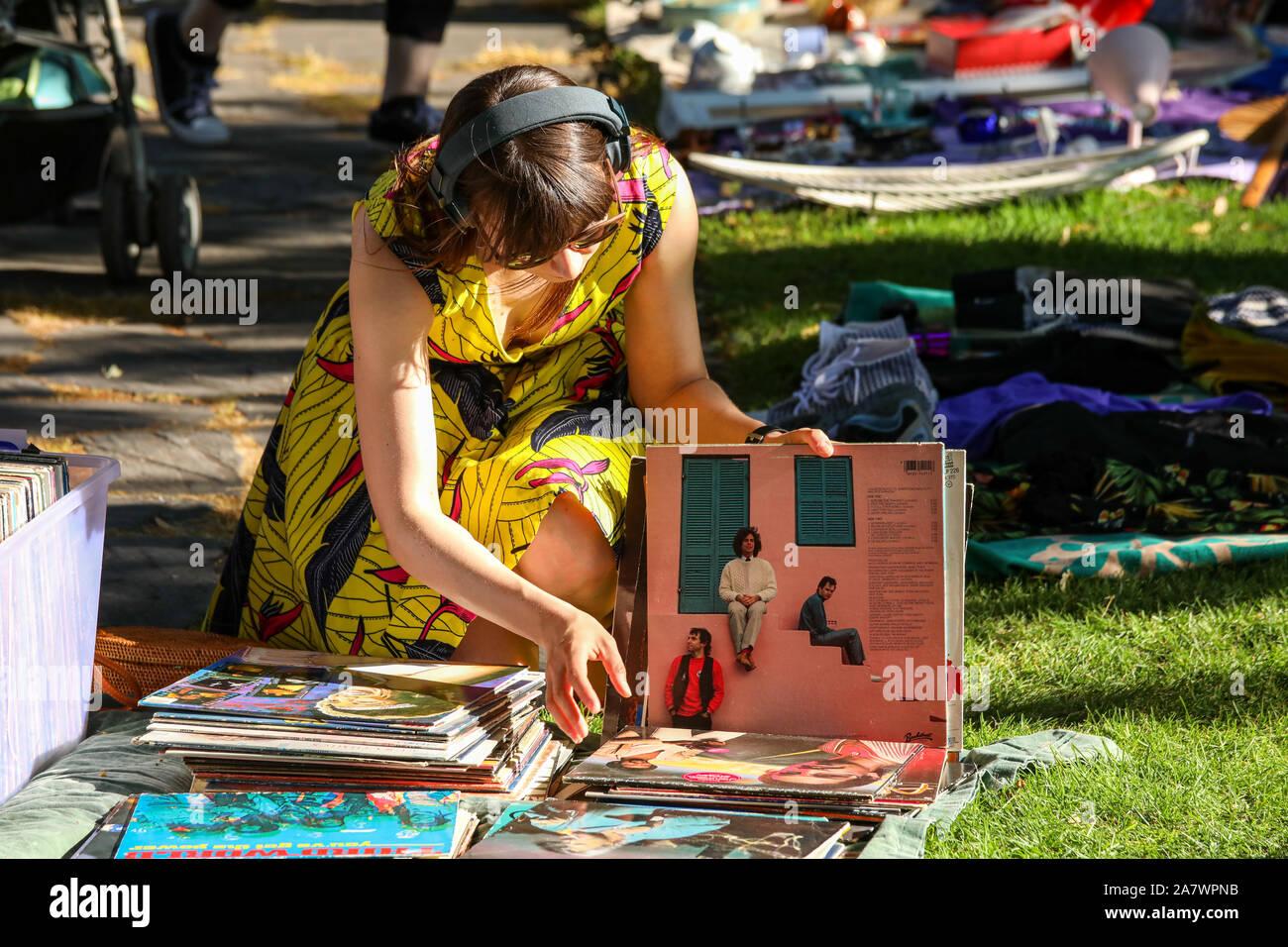 young-woman-browsing-through-vinyl-recor