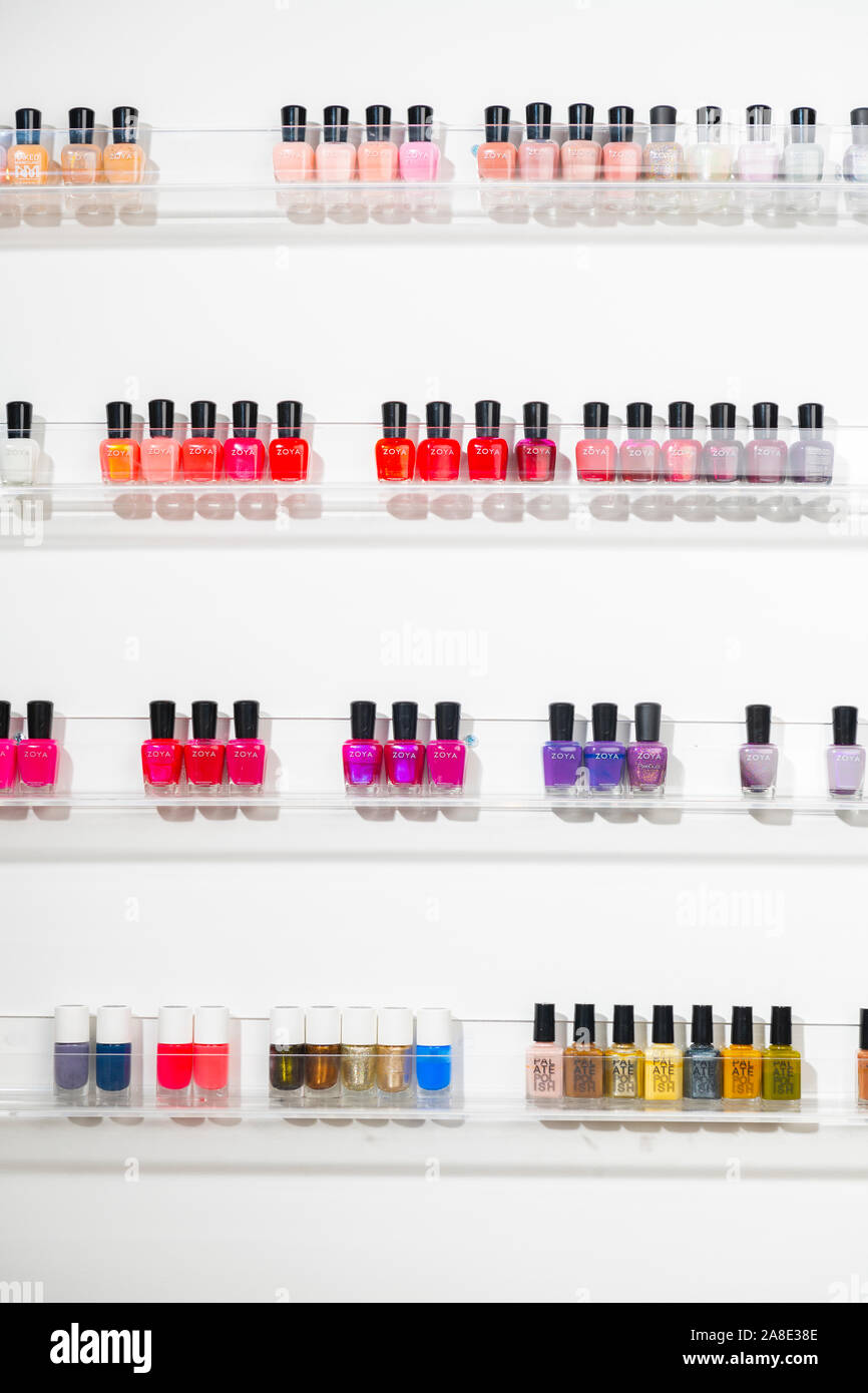 A wall of nail polish at a beauty salon Stock Photo