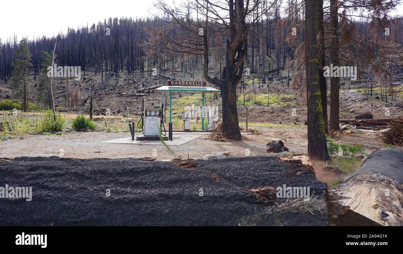 Dardanelle abandoned gas pump, left over from Donnell Fire. Burnt forest trees in the Stanislaus National Forest on Highway 108, California. Stock Photo