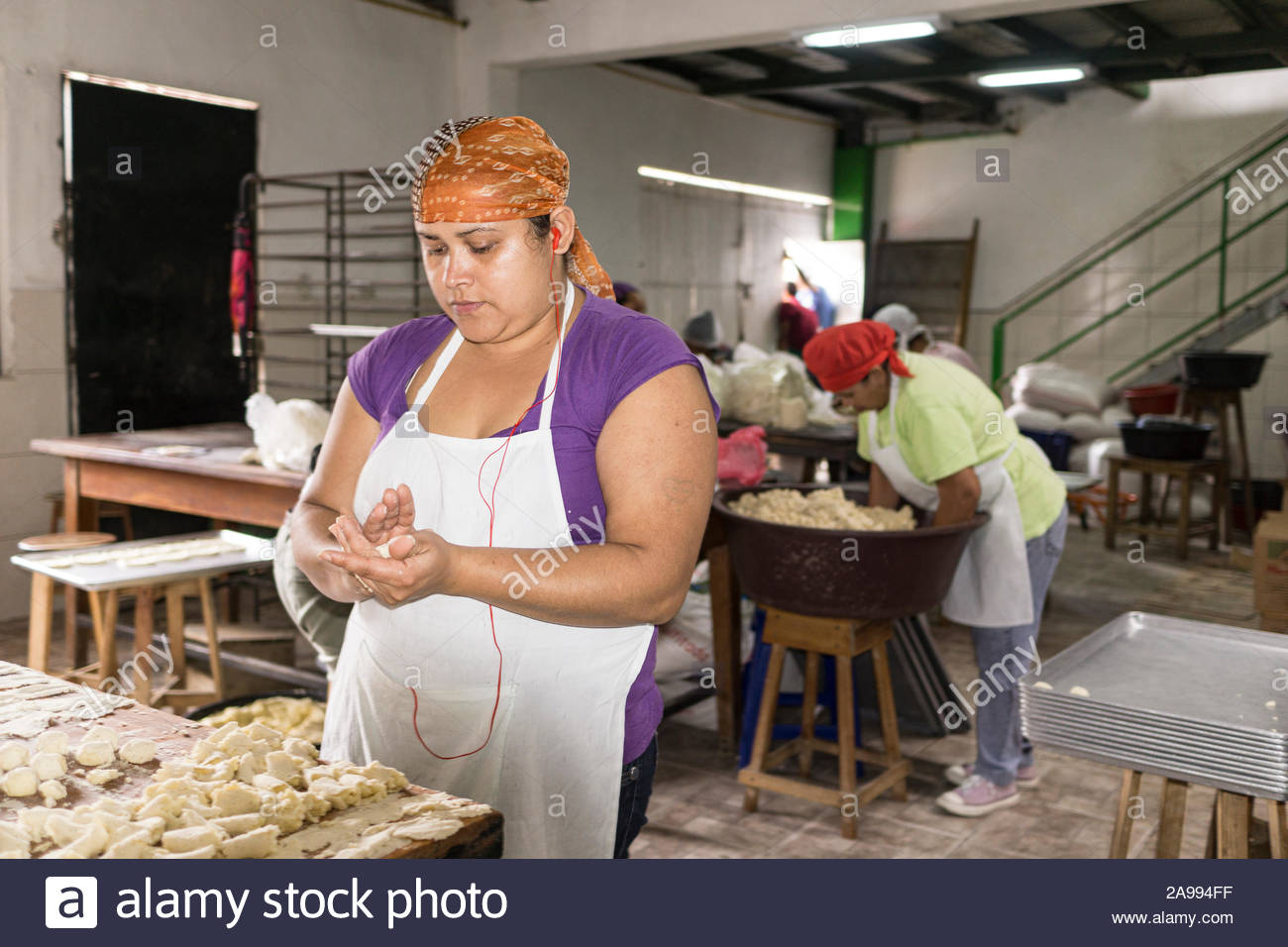 Women making rosquillas in a small factory, Rosquillas el Arbolito, in Jinotega, Nicaragua.  Rosquillas are a corn masa based pastry. Stock Photo