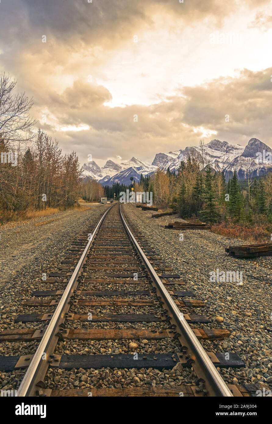 railway-line-and-distant-mountain-peaks-