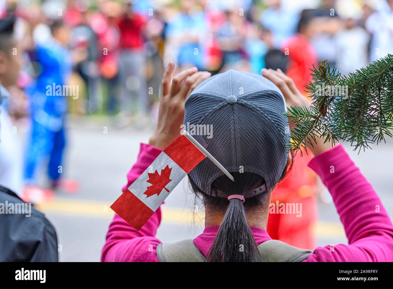 woman-taking-photos-with-her-smartphone-at-the-canada-day-celebrations-in-calgary-alberta-canada-2A9RFRY.jpg