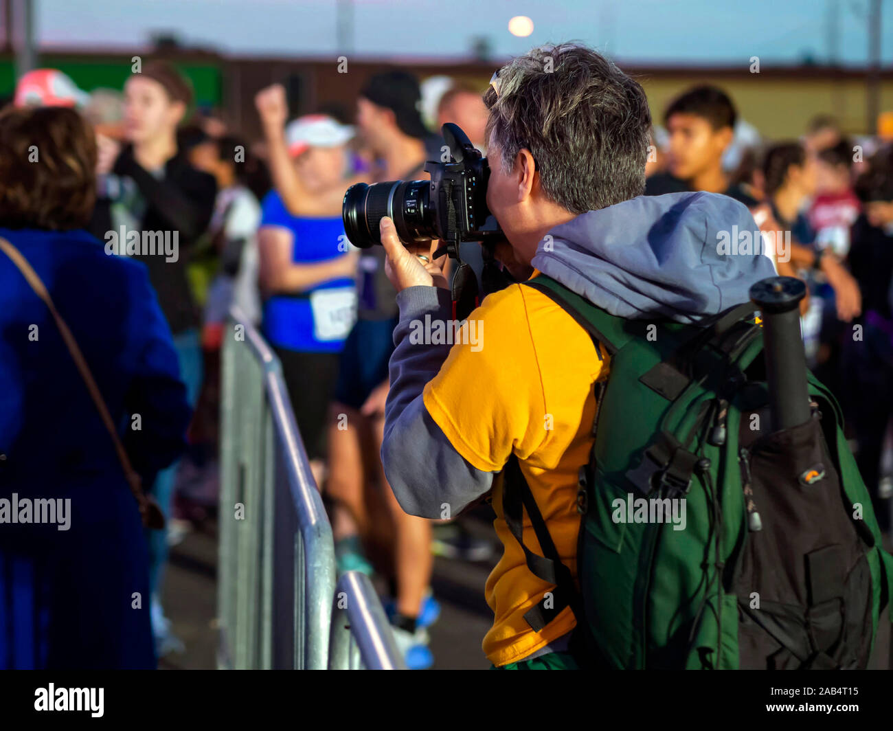 female-photographer-focuses-her-camera-on-the-crowd-of-competitors-awaiting-the-start-of-the-corpus-christi-15th-annual-harbor-half-marathon-2AB4T15.jpg