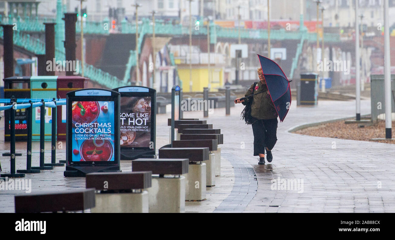 Brighton UK 26th November 2019 - A windy day on Brighton seafront as the remnants of Tropical Storm Sebastien arrive in Britain bringing strong winds and rain to most parts of the country . Credit: Simon Dack / Alamy Live News Stock Photo