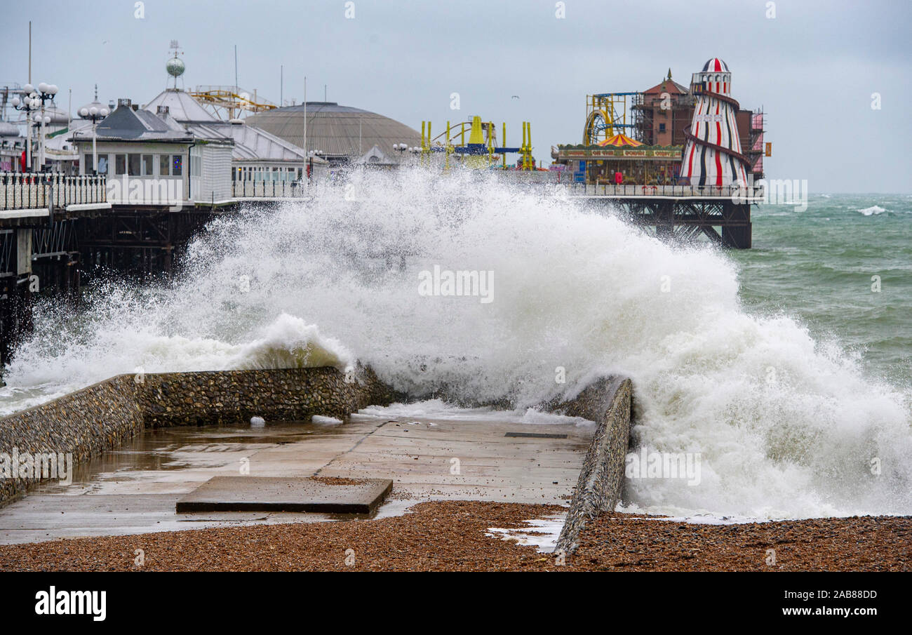 Brighton UK 26th November 2019 - Waves crash in on Brighton beach by the Palace Pier as the remnants of Tropical Storm Sebastien arrive in Britain bringing strong winds and rain to most parts of the country . Credit: Simon Dack / Alamy Live News Stock Photo