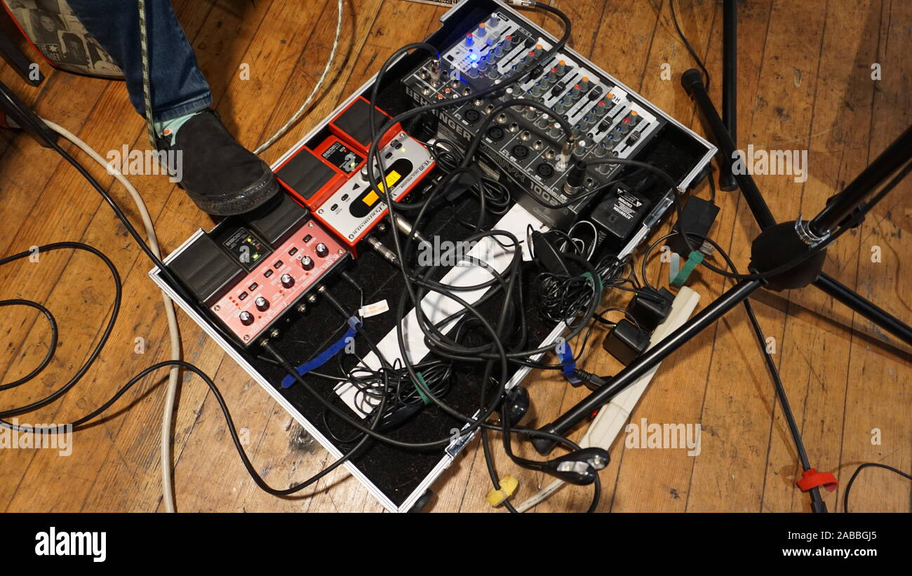 Live looping foot pedal station. Boss RC-20XL phrase recorder, Boss VE-20 vocal processor, Behringer Xenyx 1002B analog audio mixer with XLR cables. Stock Photo