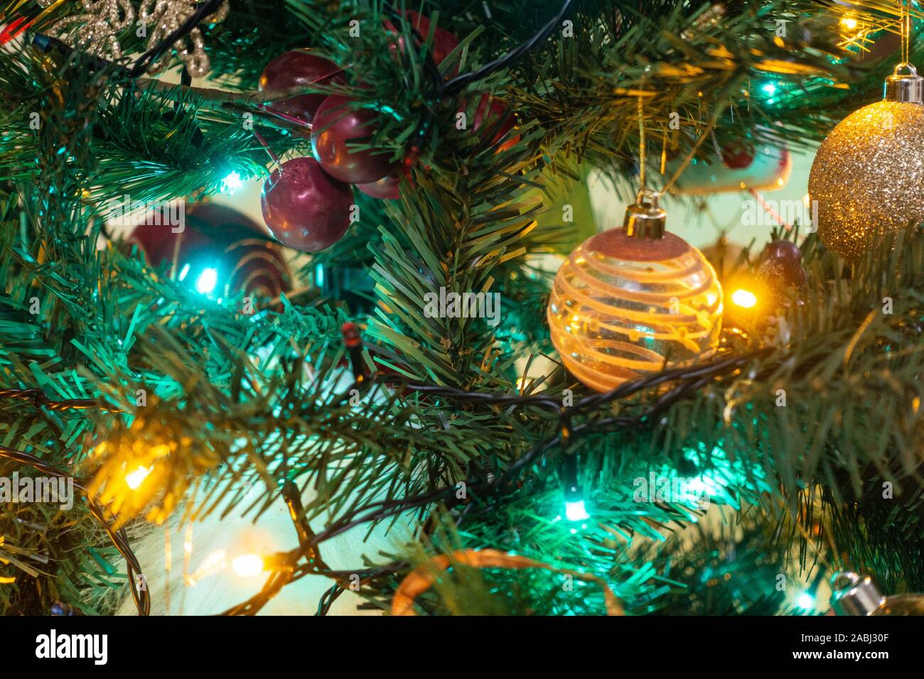 colourful-fairy-lights-and-baubles-decorate-a-christmas-tree-2ABJ30F.jpg