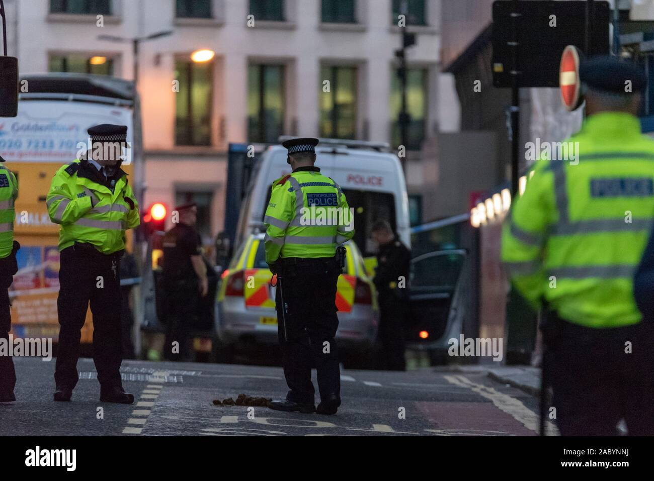 london-bridge-london-uk-29th-nov-2019-police-have-cordoned-off-a-large-area-around-london-bridge-after-a-stabbing-incident-and-gunfire-people-are-being-moved-away-from-the-area-2ABYNNJ.jpg