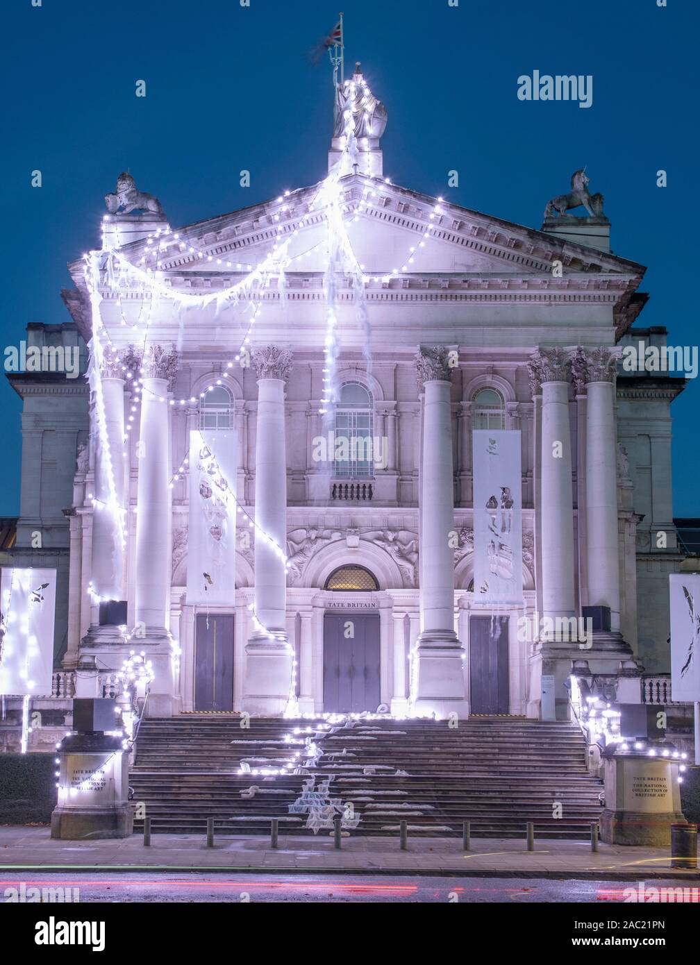 tate-britain-london-uk-29th-november-2019-the-new-tate-britain-winter-commission-devised-by-the-renowned-british-artistanne-hardy-has-transformedtate-britains-iconic-facade-into-a-marooned-temple-in-an-exploration-of-the-natural-rhythms-of-the-earth-tides-and-the-winter-solstice-unveiled-for-the-first-time-early-morning-of-29th-november-hardys-workwill-be-displayed-until26-january-2020-credit-malcolm-parkalamy-2AC21PN.jpg