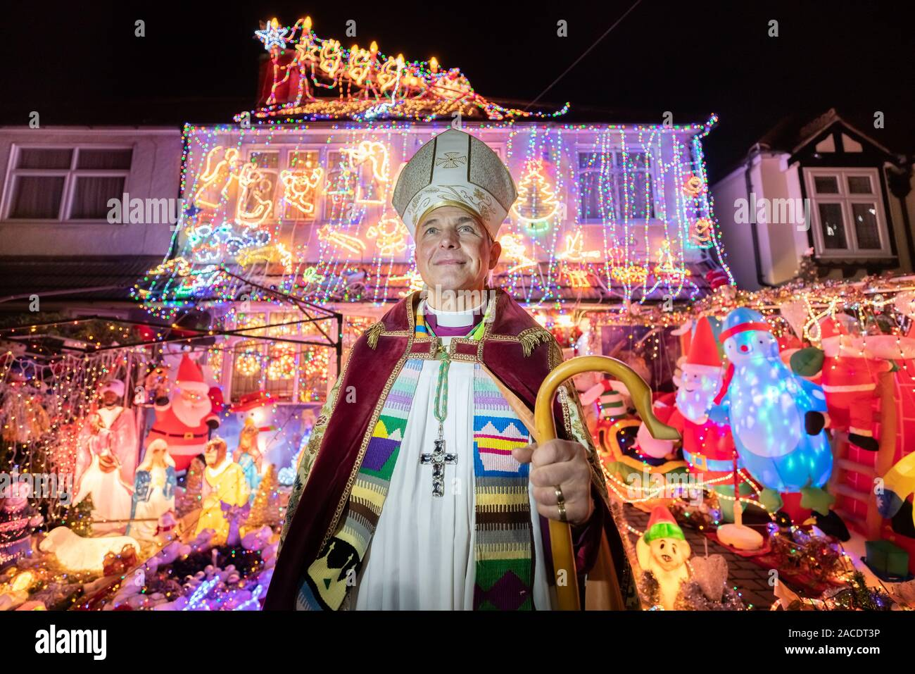 London, UK. 2nd Dec, 2019. Christmas house lights display in Welling. Bishop Jonathan Blake (pictured) and his family have decorated their home every year since 2002. For some of the local children, 'the Christmas House' as they call it, is a vital part of their Christmas experience. Bishop Blake will use this year's light display to help raise funds to provide clean water to Tiaba Nyass, a small village in the Gambia. Credit: Guy Corbishley/Alamy Live News Stock Photo