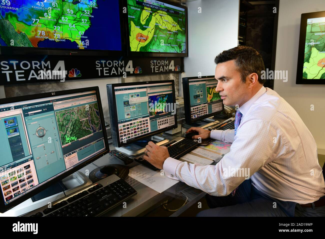meteorologist-working-on-a-weather-forecast-prediction-for-a-washington-dc-television-station-2AD19WP.jpg