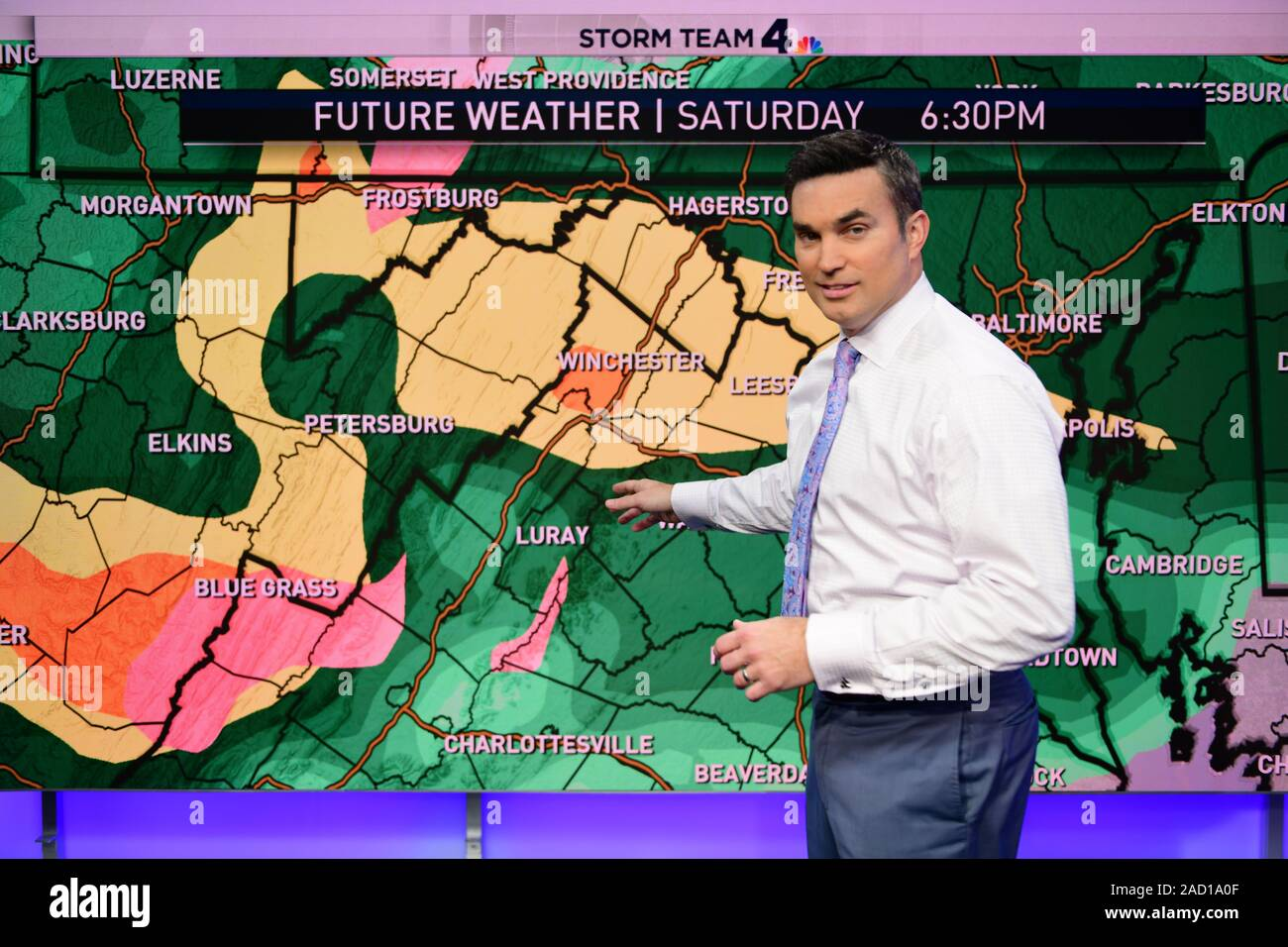 Meteorologist working on a weather forecast prediction for a Washington DC television station Stock Photo