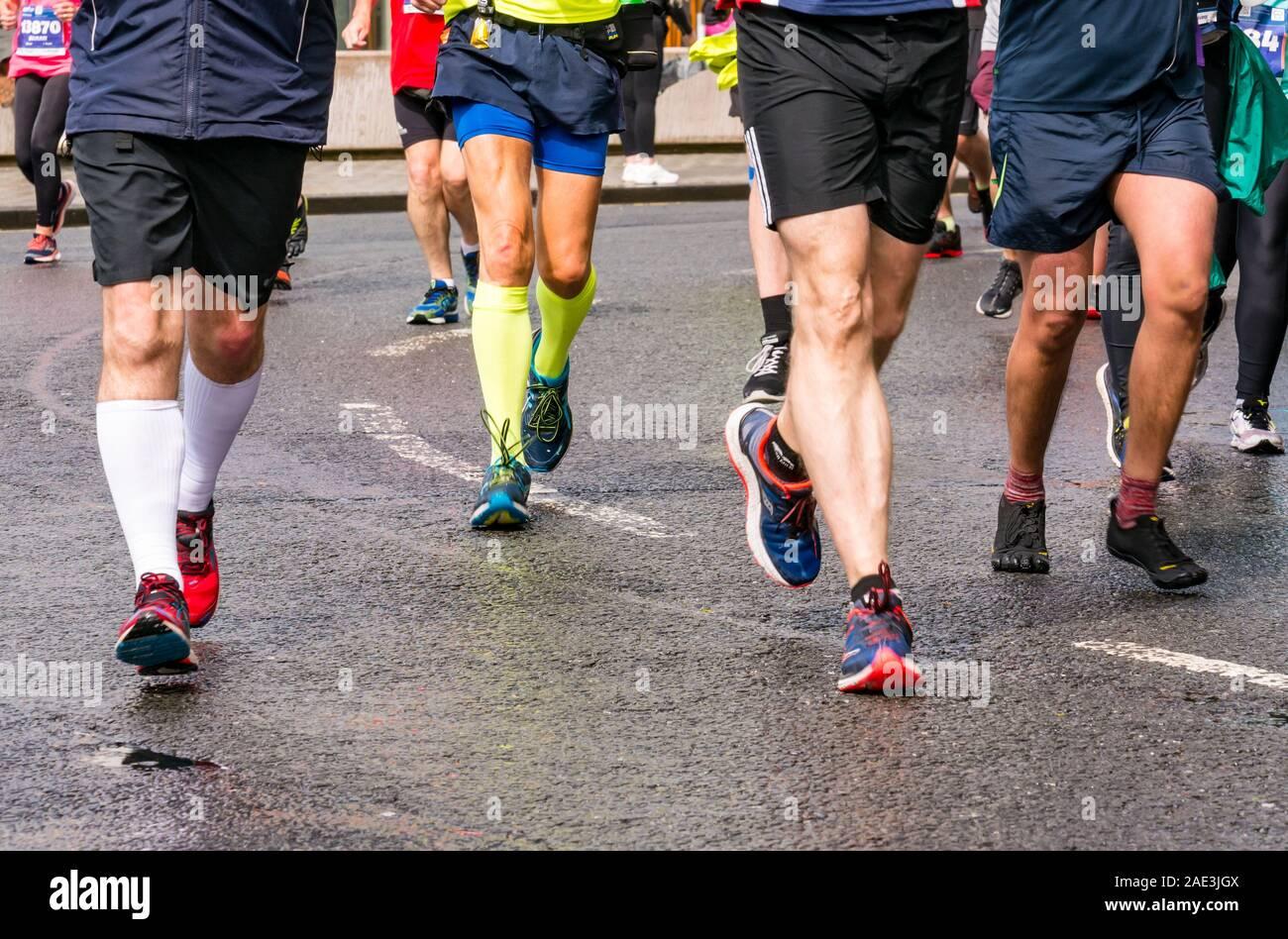 close-up-runners-legs-feet-running-shoes
