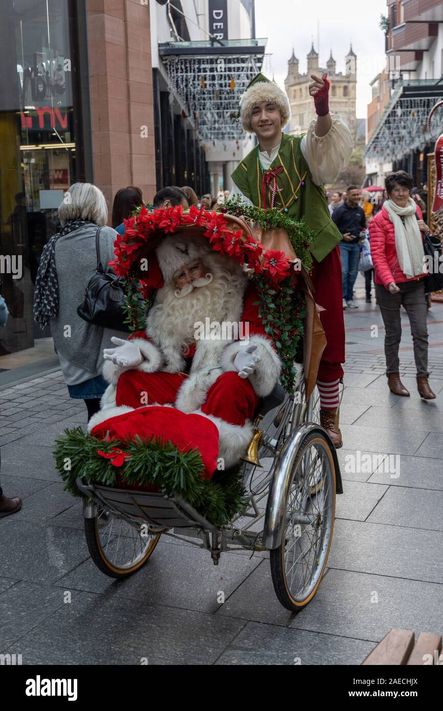 Father Christmas and elf at Princesshay, Exeter Stock Photo