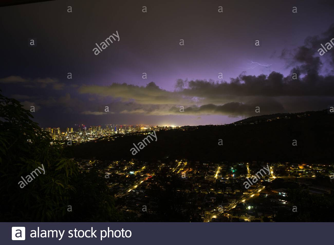 Lightning illuminating storm clouds over Honolulu, Oahu, Hawaii, USA Stock Photo