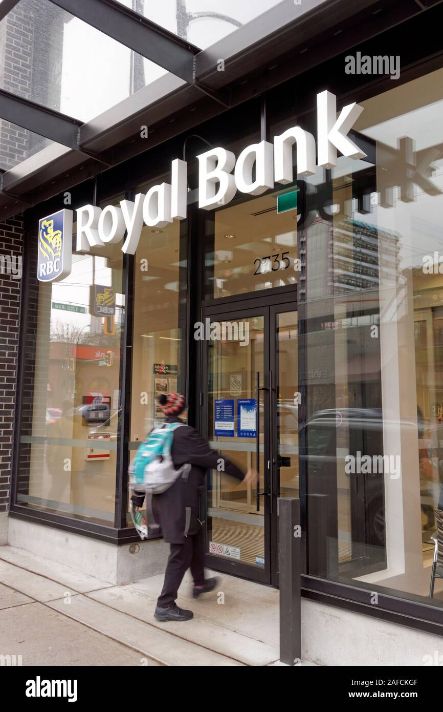 woman-entering-a-royal-bank-of-canada-rb