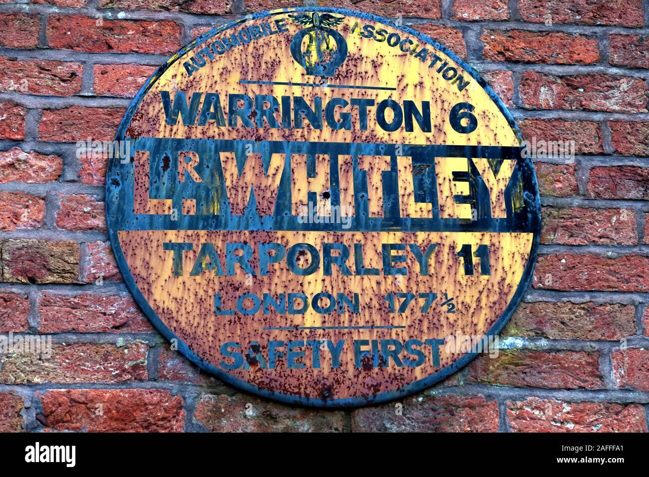 @HotpixUK,HotpixUK,GoTonySmith,AA,on wall,wall mounted,history,motoring,Warrington 6 miles,Tarporley 11 miles,London 177,Safety First,village,Lower Whitley Village,sign,WA4,circular,circular sign,yellow black,yellow,black,distance,distances,A49,road,rust,rusty,old,Antique AA Road sign,Antique,AA Road sign,AA Sign,British brick world