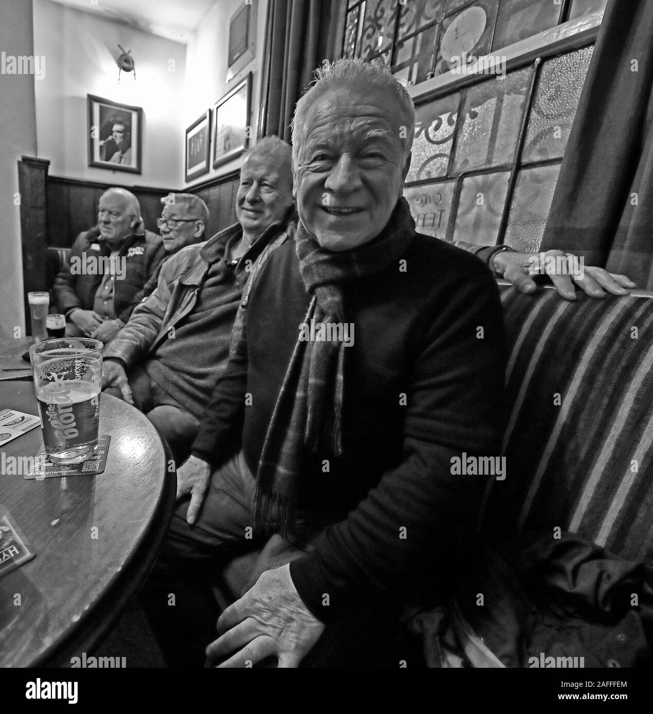 @HotpixUK,HotpixUK,GoTonySmith,@HotpixUk,ale,beer,Tavern,Manchester,customers,men,man,blokes,inside,interior,The Circus,city centre,smallest public house,smallest,1790,Grade II building,Grade II,building,Tetley,Tetleys,historic,oldest pubs in Manchester,oldest pub in Manchester,drinkers,drinker,men in a pub,man in a pub,BW,Black and White,Monochrome,bitter,lager,pints,on a table,round