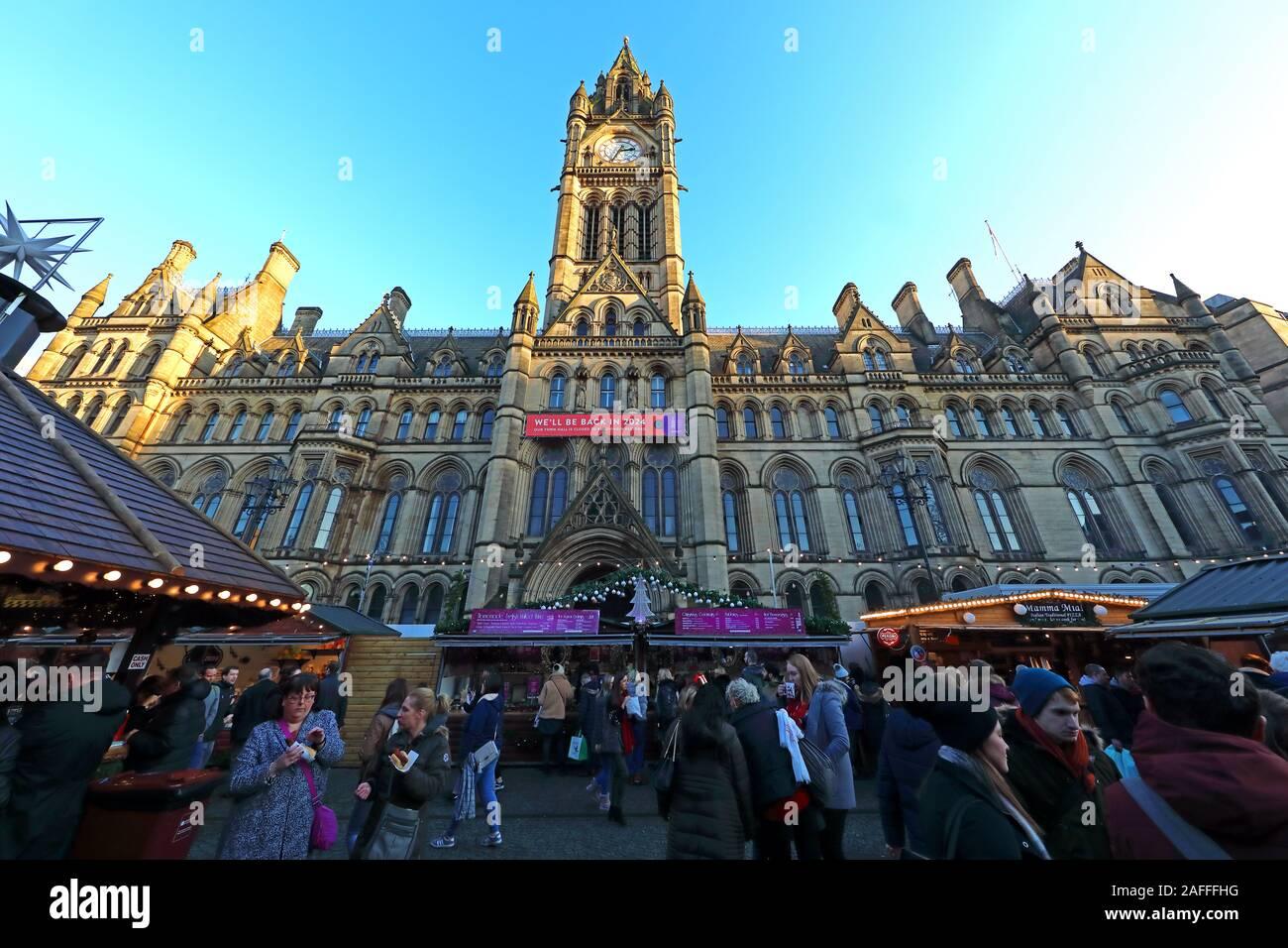 @HotpixUK,HotpixUK,GoTonySmith,@HotpixUk,England,UK,M2 5DB,Xmas Market,Xmas,December,stalls,clock,tower,clocktower,people,crowds,Victorian,Gothic,building,Albert Memorial,stall,bars,pub,bar,shoppers,retail,drinkers,eaters,food,mulled wine,Greater Manchester