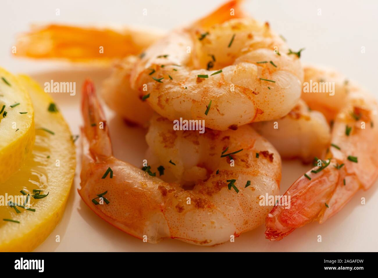 close-up-view-of-whole-freshly-cooked-and-peeled-prawns-or-shrimps-on-bright-white-background-as-gourmet-seafood-concept-2AGAFDW.jpg