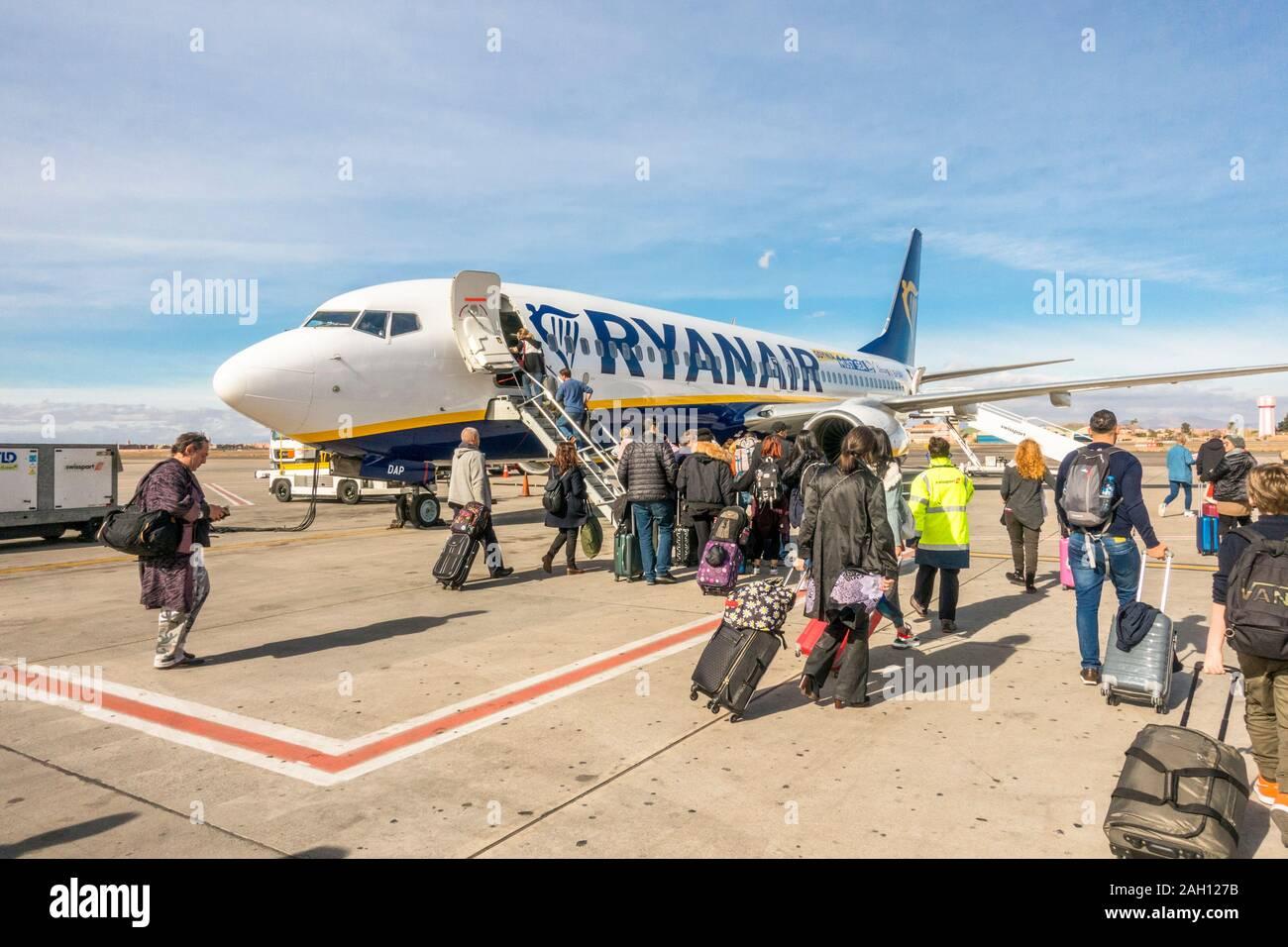 Passengers boarding Ryanair aircraft, Airport Marrakesh, Morocco. Stock Photo