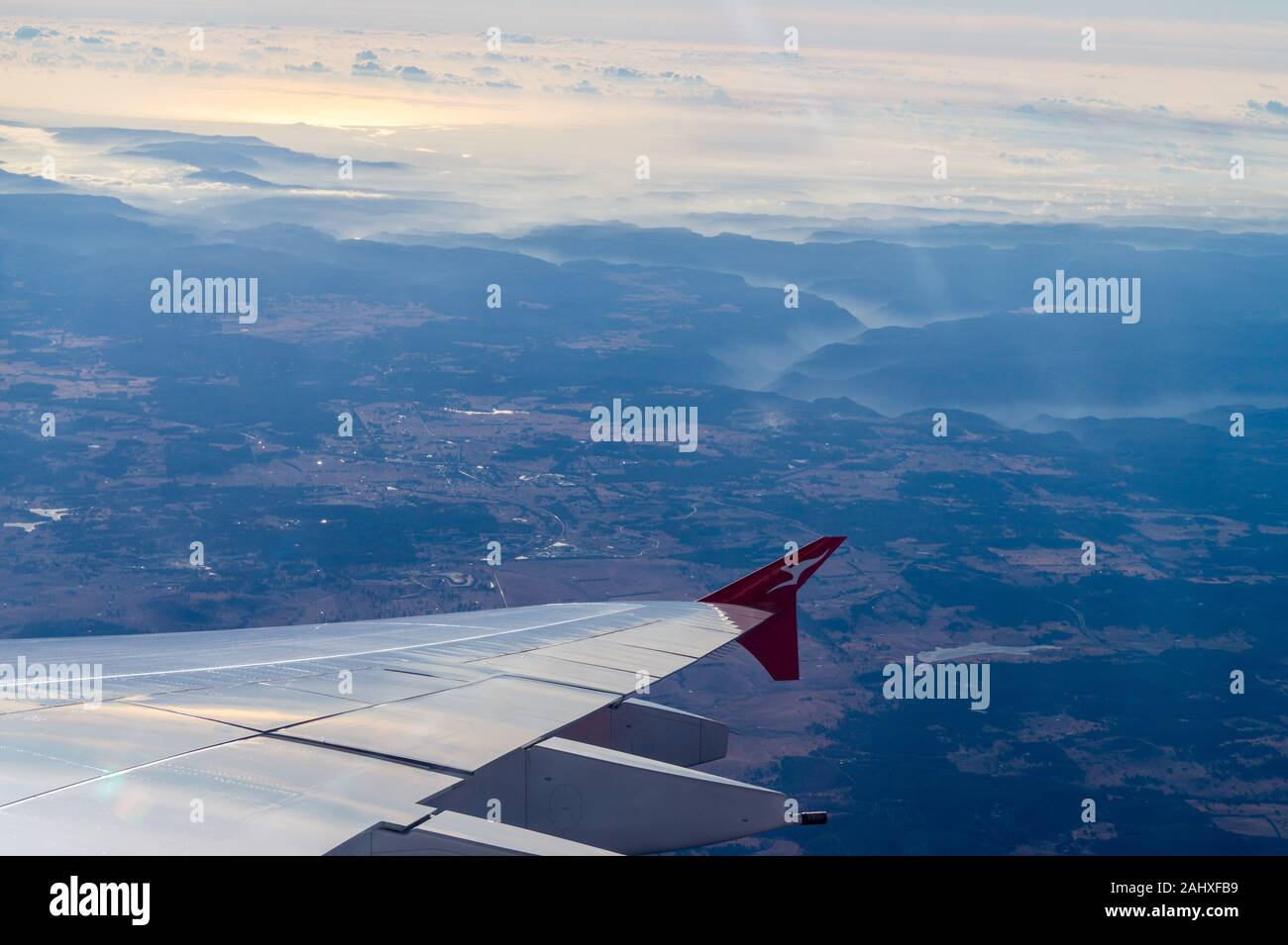 smoke-from-bush-fires-seen-from-a-qantas-airbus-a380-airliner-approaching-sydney-airport-at-sunrise-australia-2AHXFB9.jpg