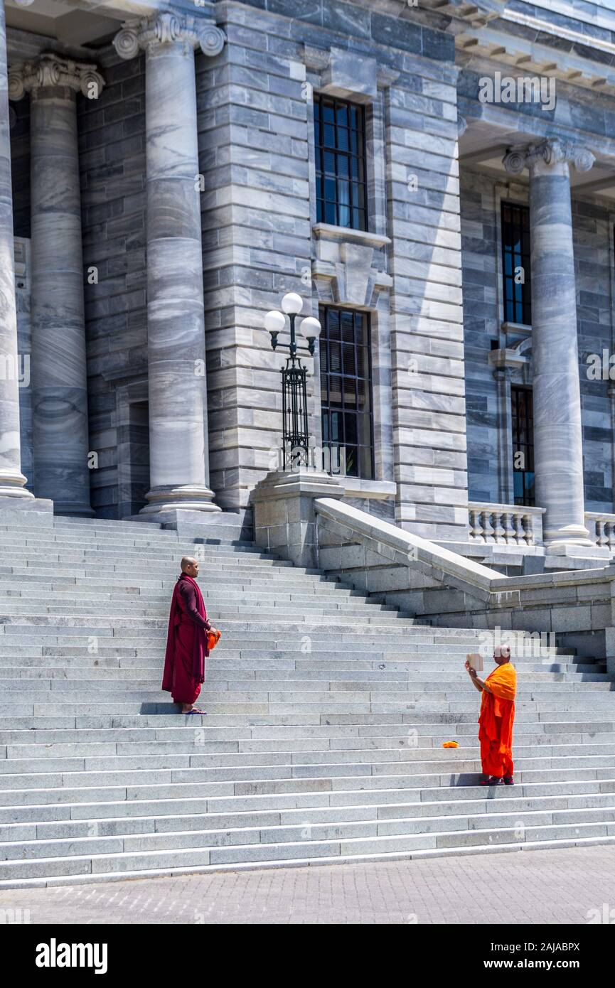 buddhist-monks-taking-selfie-photographs-on-the-steps-of-parliament-house-wellington-new-zealand-2AJABPX.jpg