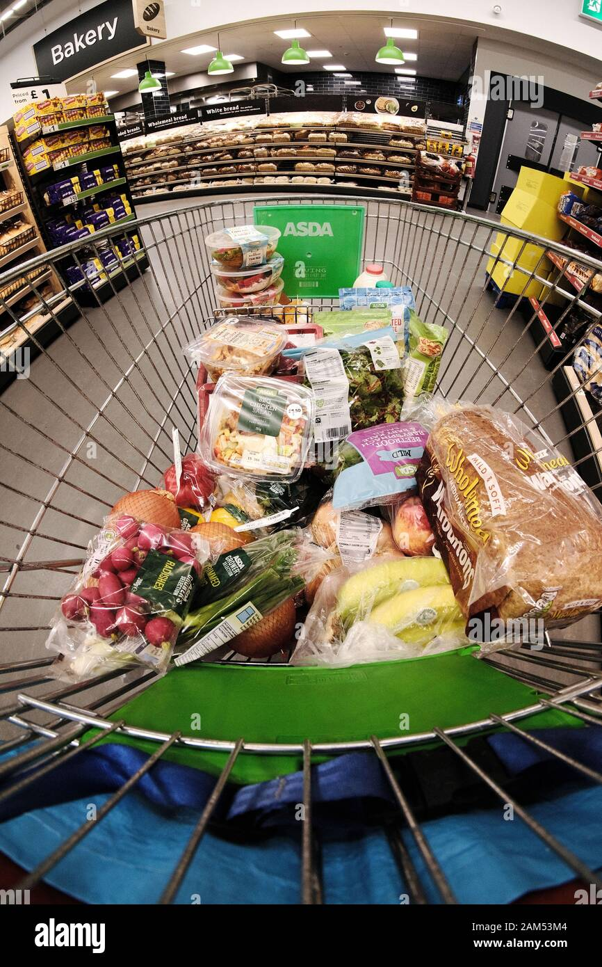 an-asda-supermarket-trolley-half-full-of
