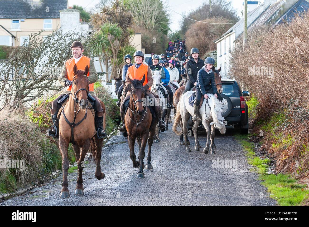 butlerstown-west-cork-ireland-12th-jan-2020-the-annual-carberry-hunt-butlerstown-fun-ride-took-place-today-with-hundreds-of-horses-and-riders-taking-part-the-horses-approach-the-beach-at-broadstrand-credit-andy-gibsonalamy-live-news-2AMB72B.jpg
