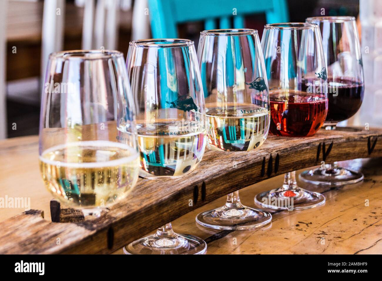 Tasting paddle with a flight of Pinot Noir, Pinot Rosé, Pinot Gris, Chardonnay and sparkling Margrain vineyard, Martinborough, Wairarapa, New Zealand Stock Photo