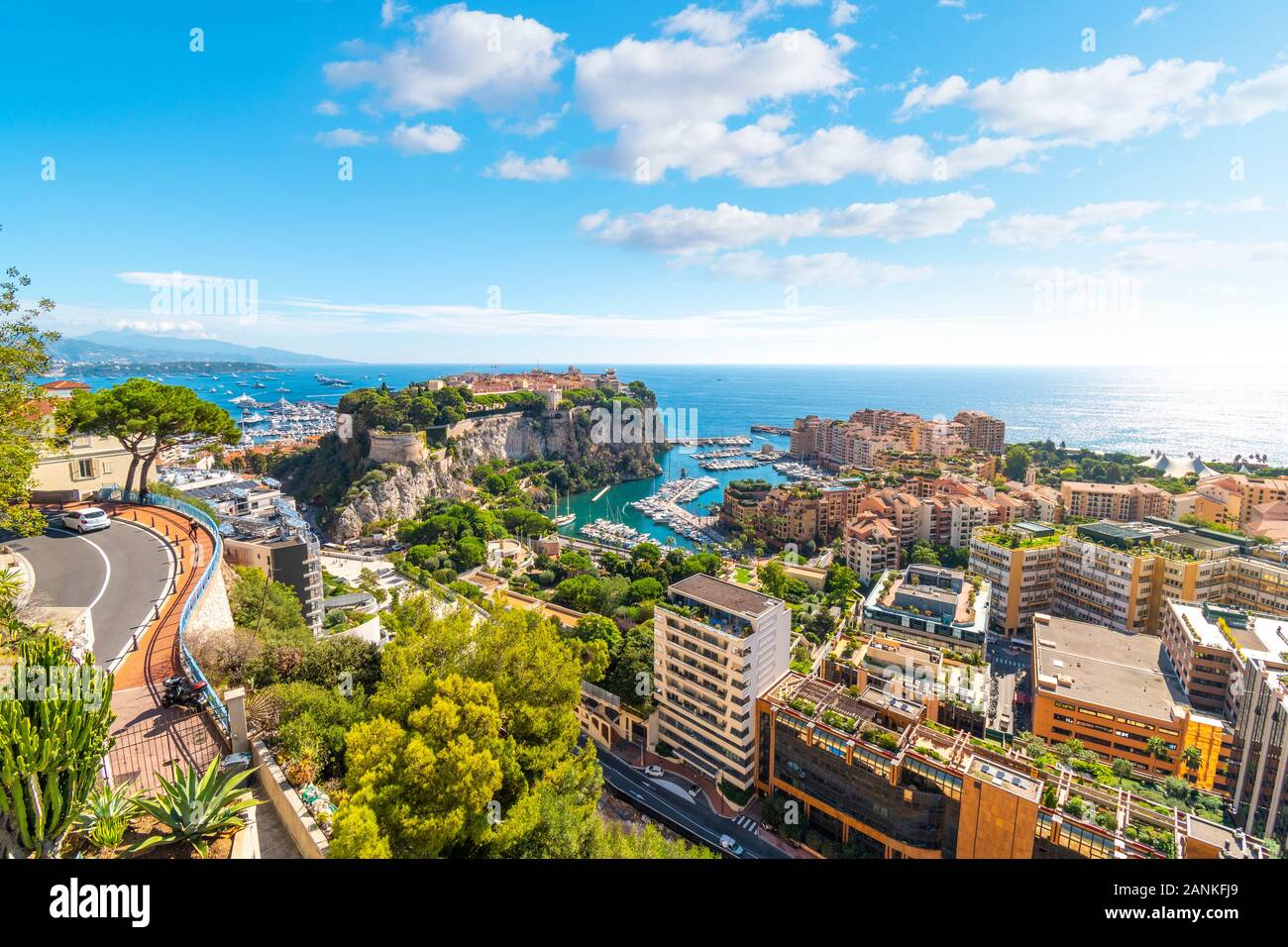 View of the Mediterranean Sea, the marina, port, cities of Monte Carlo and Fontvieille, and the rock of Monte Carlo, Monaco, from the Exotic Gardens Stock Photo